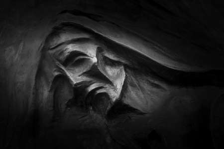 depicting: Sculpture depicting Death, in an Italian cemetery.