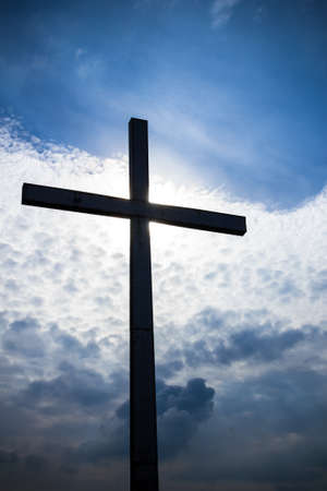 cross: A large iron cross, immortalized in backlight. Stock Photo