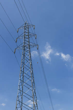 airwaves: Pylon with blue sky and clouds in the background.