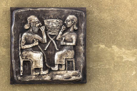 mesoamerica: An ancient Mayan relief on bronze tablet with golden tones.
