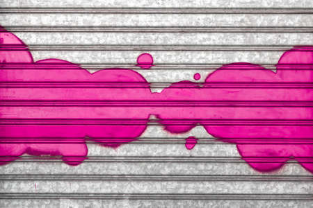 pink bubbles: Pink bubbles painted with spray paint on a roller shutter.