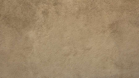 characterized: Front view of a wall characterized by rough plaster, sand-colored Stock Photo