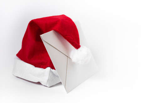 wishlist: White letter and Santa Claus hat, isolated on white background.
