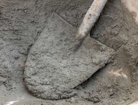 site preparation: Mortar preparation, on construction site, with shovel and wheelbarrow.