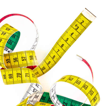 thinness: Top view of a tailor meter, yellow on one side and with the colors of Italy on the other side.