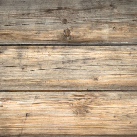 hues: Background characterized by wooden planks rustic and warm hues. Stock Photo
