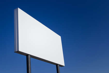 landscape format: Big ad panel blank, customizable in landscape format and isolated on blue sky Stock Photo