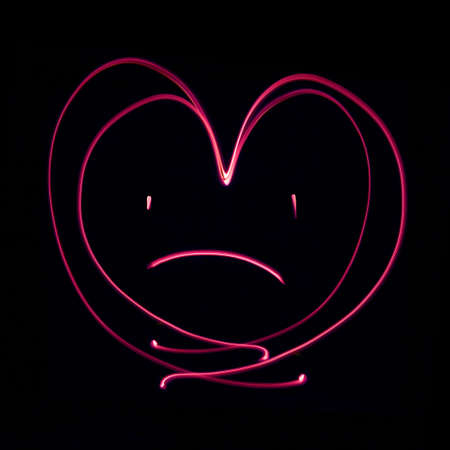 sad heart: Sad heart generated by a beam of green light, with long exposure.