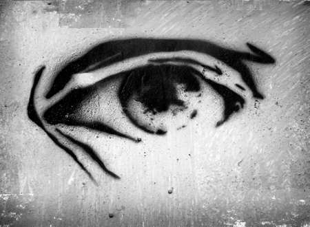 opened eye: Eye with eyebrow. Art of graffiti. Opened eye on grungy wall. Eye on plaster background. Ink drops. Gray color. Texture for design and formalization.