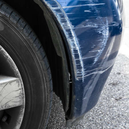 front side: Accident damage to the front side of a blue car. Stock Photo