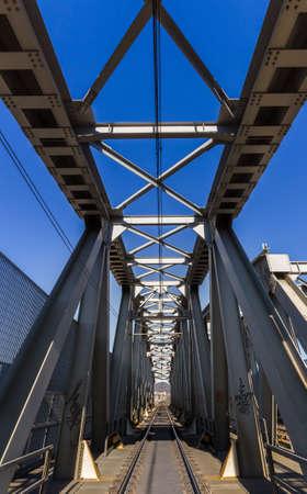 floating bridge: Modern railway steel bridge over highway