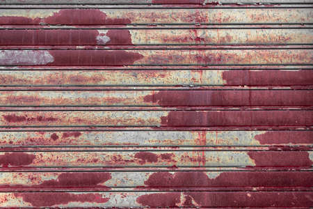 rolling garage door: Roller shutter door, rusty metal background. Stock Photo