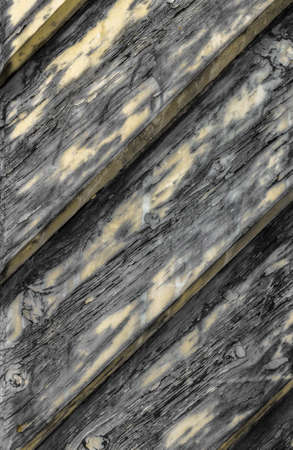 lopsided: Background of diagonal old weathered planks painted in yellow