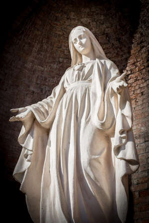virgin women: Statues of Holy Women in Roman Catholic Church on wall background. Stock Photo