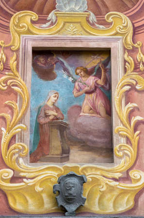 angel gabriel: Details of fresco of Annunciation on facade of an italian church. Stock Photo