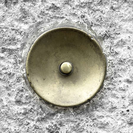 oxidized: Extreme close-up of an antique brass doorbell, oxidized by the time.