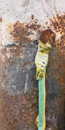 grounding: Old grounding cable with rust and corroded areas. Stock Photo