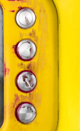 disturbing: Details of a yellow intercom with disturbing traces of blood on the call keys. Stock Photo