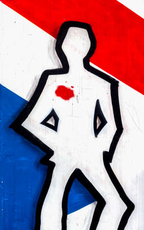 victims: Human silhouette with blood stain, against the French flag. A conceptual representation of French victims of ISIS.