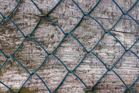 nailed: Diamond fence nailed on wood panel. Stock Photo