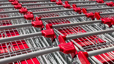 departmentstore: Row of red shopping carts at department store Stock Photo