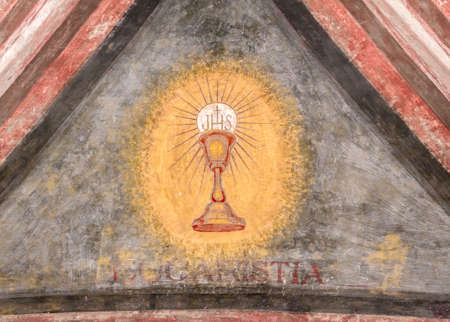 italian fresco: A fresco depicting the sacred chalice of Jesus. Eucaristia in Italian means: Eucharist, Holy Communion, Communion. Stock Photo