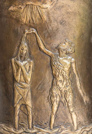 the gospels: Copper bas-relief depicting the baptism of Jesus by John the Baptist.