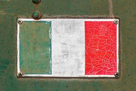 old sign: Italian flag on rusty old enamel sign
