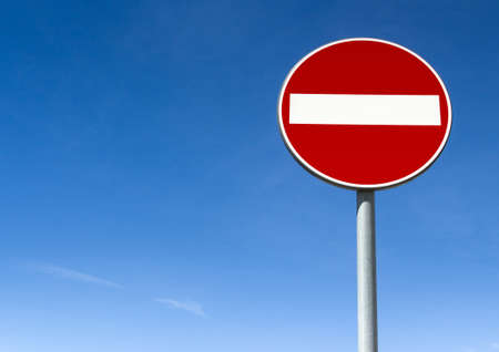 disallowed: Road sign ban of access against the blue sky, with copy space.