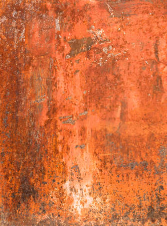 Bright orange panel with oxidized or rusty marks produce a colorful painted surface that is full of texture and patterns.