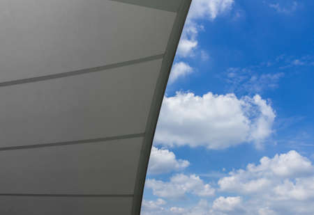 Detail of tensile shading roof against blue sky
