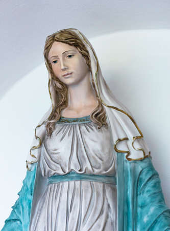 Statue of holy woman isolated on light background Stock Photo