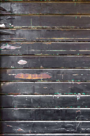 security shutters: Old steel rolling shutter background. Grungy and rotten tone color.