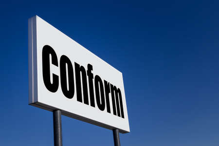 conform: Big ad panel, embossed with the message CONFORM, against blue sky.