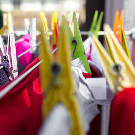 Clothes pegs on washing line. Extreme close-up. Defocused blurry background. Stock Photo