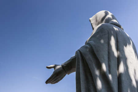 jesus statue: A jesus statue raising his hands to the heavens in prayer