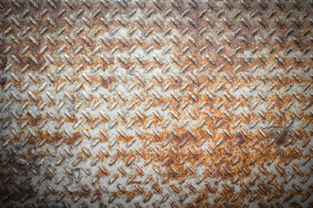 nonslip: Steel floor for background or texture. Front view of a rusty panel with non-slip surface.