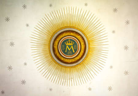 Monogram of the Blessed Virgin Mary, with crown, sun and stars on the background.