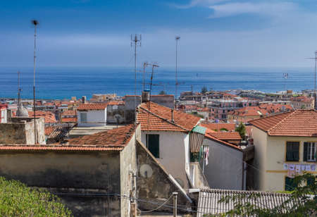 collina: Ancient town on the Ligurian Sea: Sanremo ITALY. Roofs with satellite dishes and tv antennas.