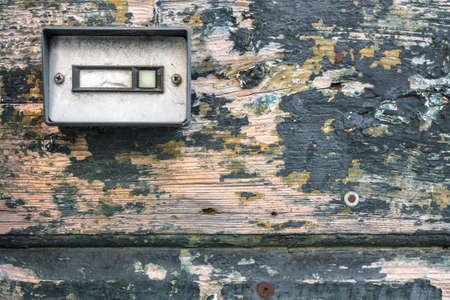bell bottoms: Retro doorbell on old wood door Stock Photo