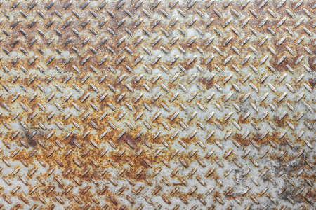 diamondplate: Steel floor for background or texture. Front view of a rusty panel with non-slip surface.