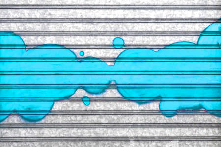 Light blue bubbles painted with spray paint on a roller shutter.