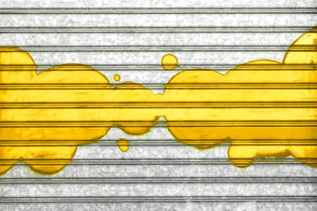Yellow bubbles painted with spray paint on a roller shutter