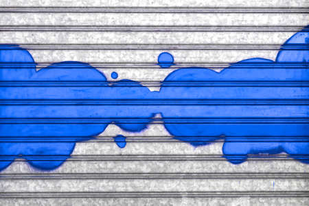 Blue bubbles painted with spray paint on a roller shutter. Stock Photo