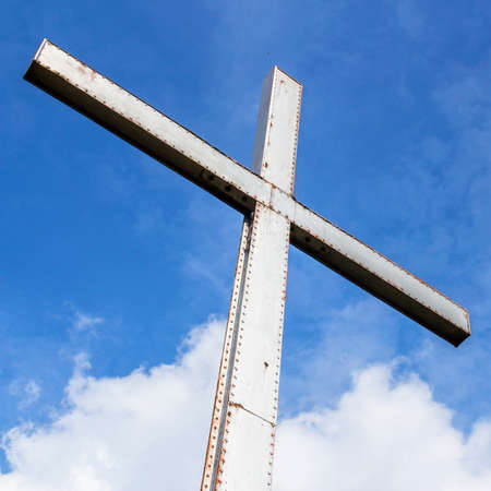 Iron Cross Over A Blue Sky With Clouds Background Universal Stock