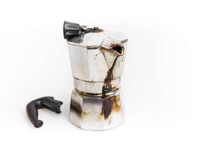 Vintage Moka pot forgotten on the fire. Burned with in molten plastic components. Reklamní fotografie