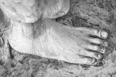 stigmata: Extreme close-up of the feet of Jesus Christ. Top view. Shallow depth of field. Stock Photo