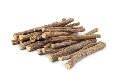 Liqorice roots on white background