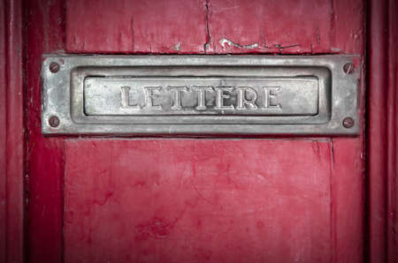 Vintage grunge letter box on wooden door Stock Photo