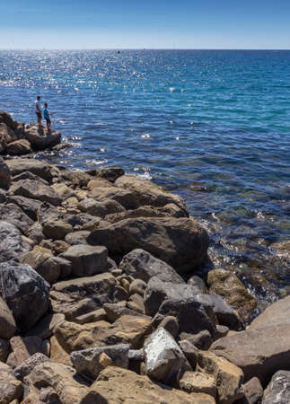 Amazing sea with blue summer wave and rocks. Summer sea background. Stock Photo